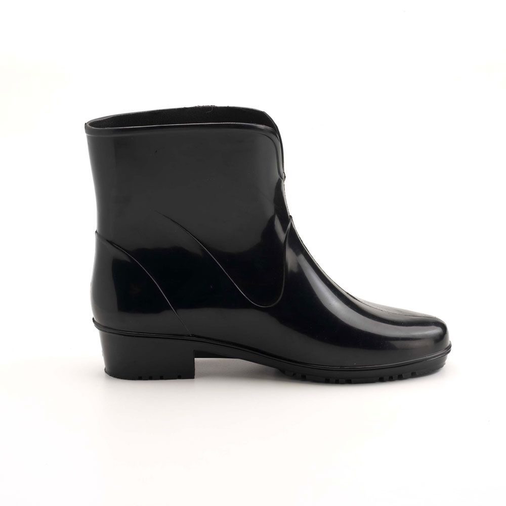 "Solid colour ankle boot  in bright PVC, with heel and ""V"" necked upper, classic boot style"