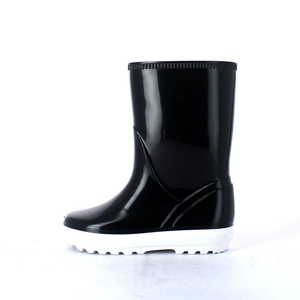Children rainboot made of two-colour pvc with bright finish and sneaker type outsole