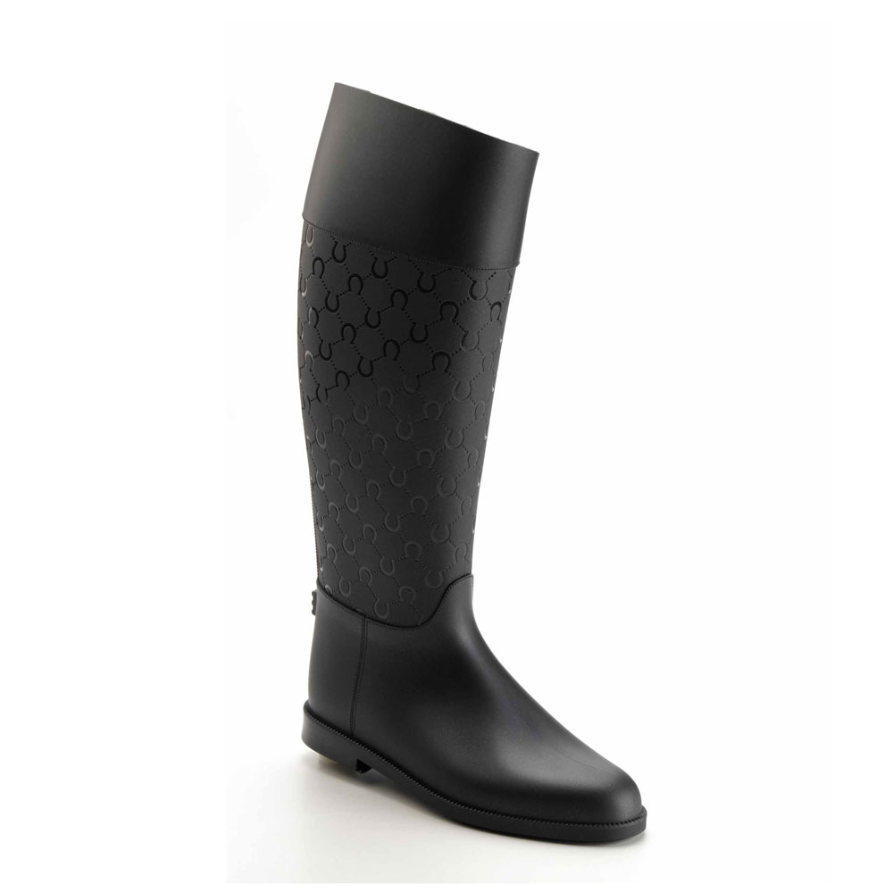 Riding boot in matt pvc with high boot leg featured by photoengraved quilt effect print