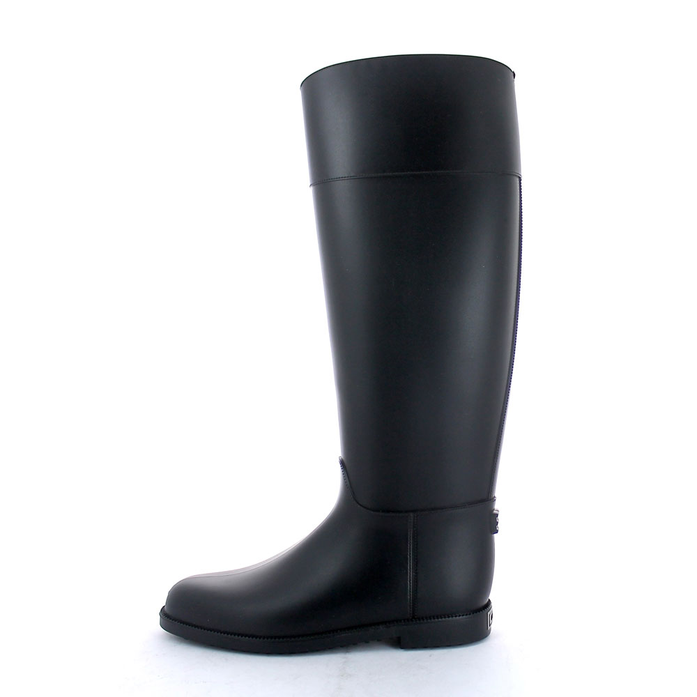 Riding boot with high boot leg and made of solid colour PVC with matt finish
