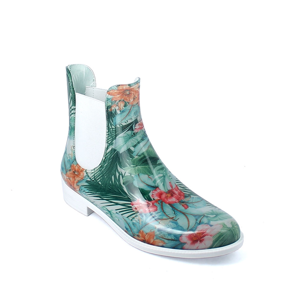 "Chelsea boot in bright transparent pvc with elastic band on ankle sides and cut &sewn inner sock with pattern ""Green Tropical Flowers"""