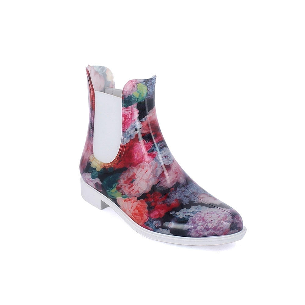 "Chelsea boot in bright transparent pvc with elastic band on ankle sides and cut & Sewn lining with pattern ""Ortensie"". Made in Italy"