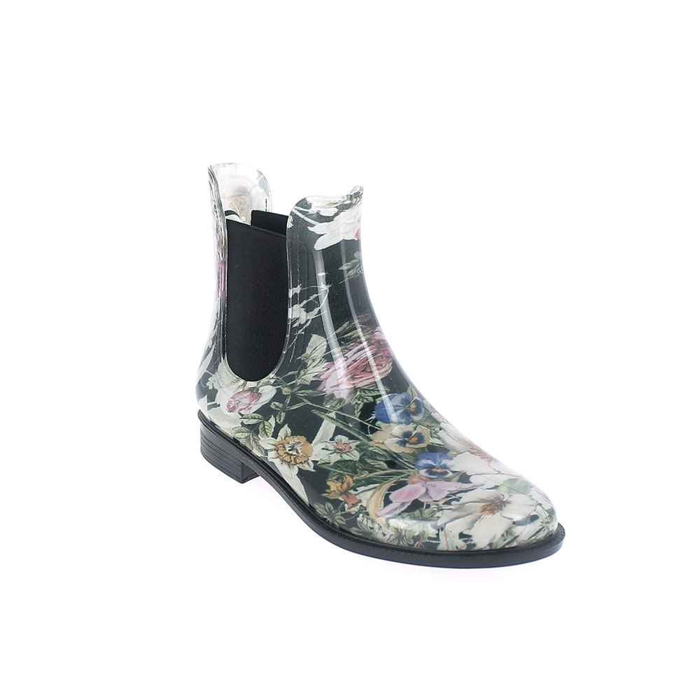 "Chelsea boot in bright transparent pvc with elastic band on ankle sides and cut & Sewn lining with pattern ""Flower"". Made in Italy"
