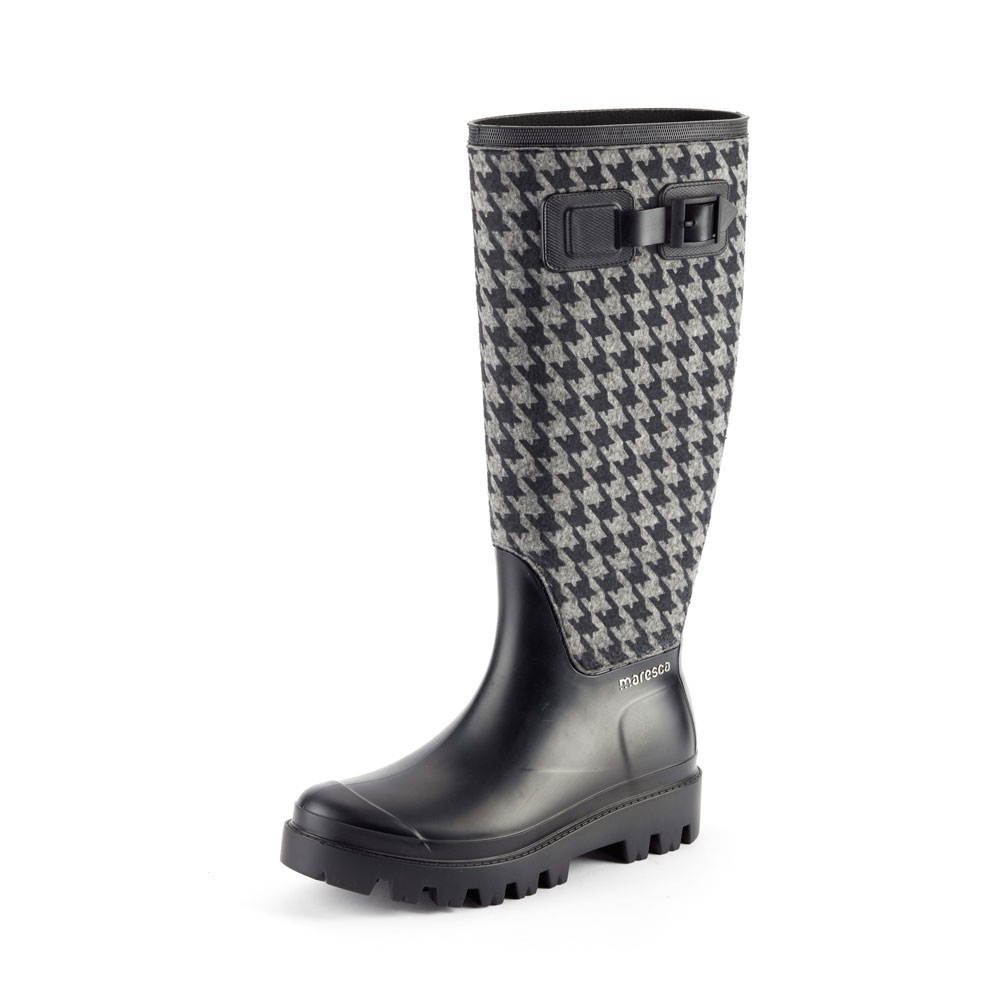 "Matt finish pvc Wellington boot with ""pied de poule"" fabric sewn on the bootleg and pvc lateral strap;  Lug outsole (VIB outsole). Made in Italy"
