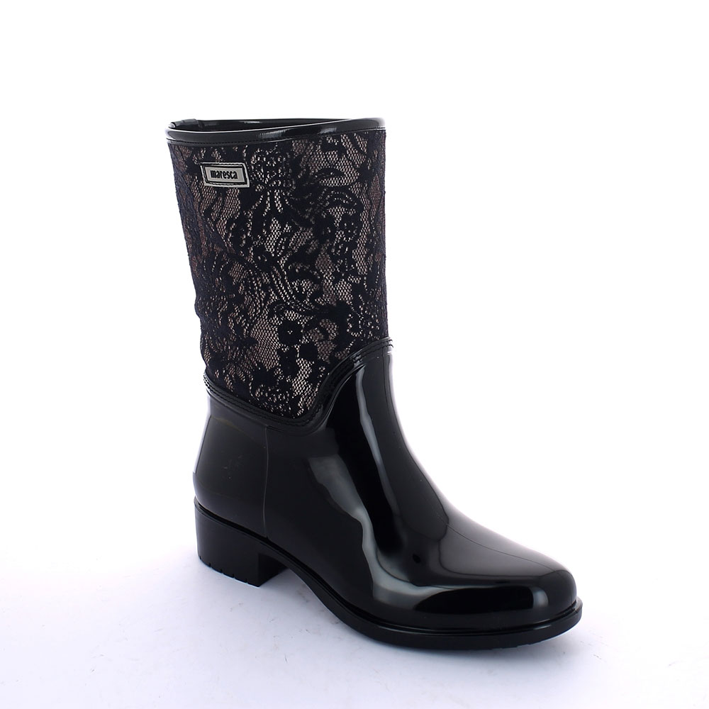 "Pvc galosh with low ""Lace"" bootleg and synthetic sheared faux fur inner lining and wool foot lining"