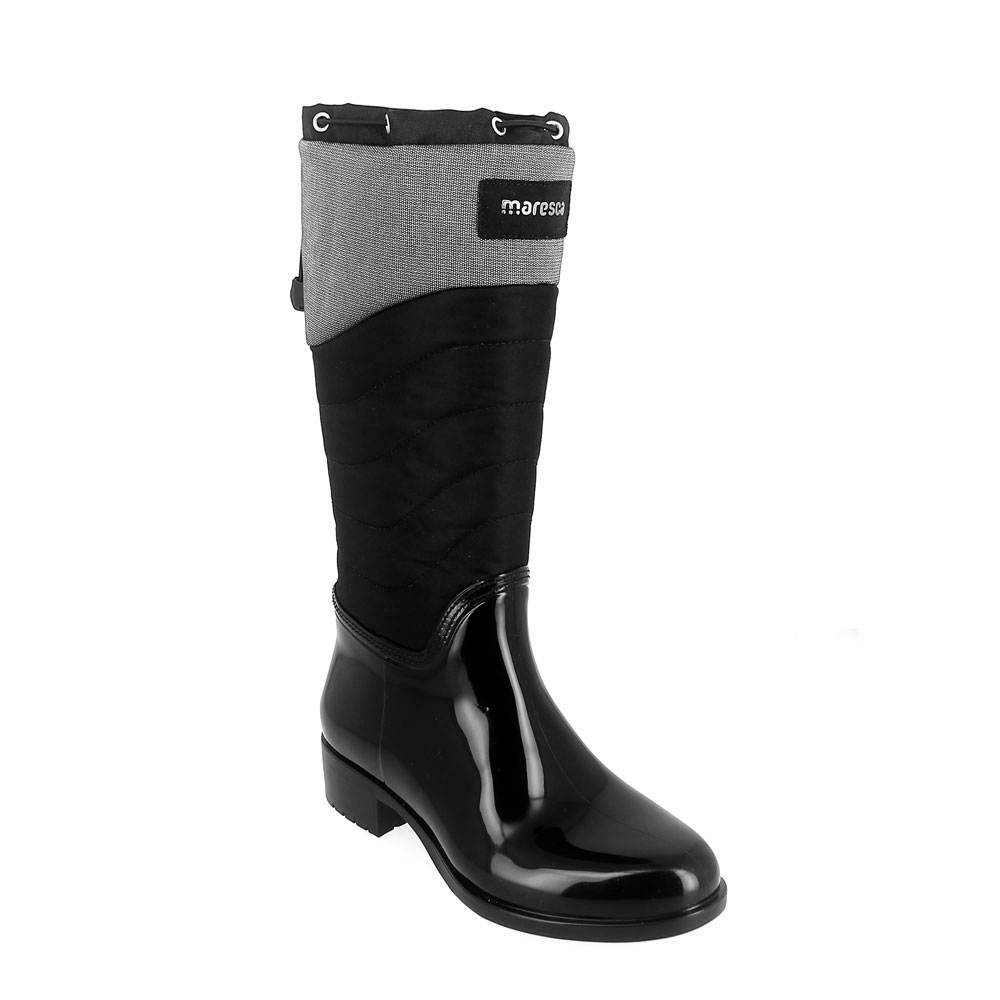 Pvc galosh with coulisse and high bootleg in a technical waterproof material with sheared faux fur inner lining and synthetic wool foot lining. Made in Italy