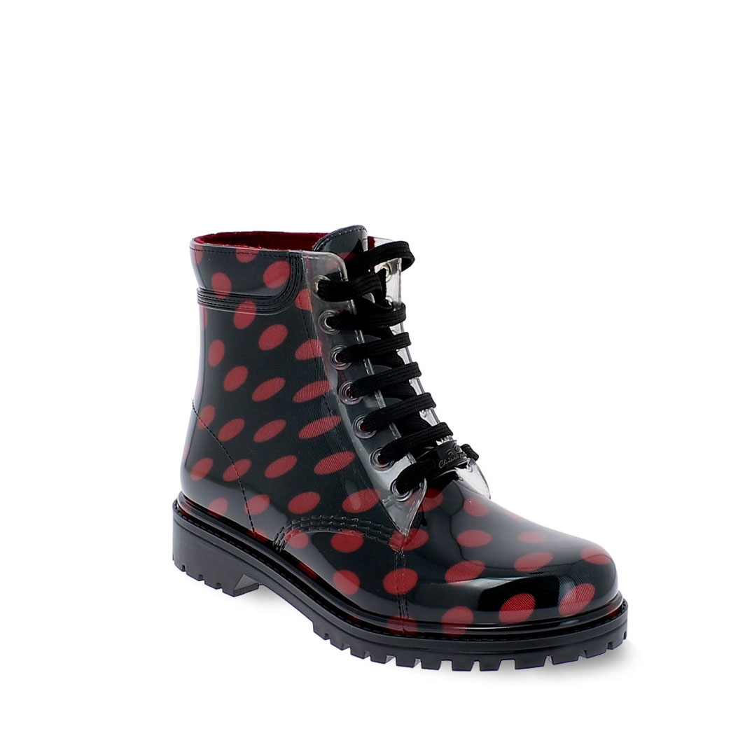 "Short laced up boot in transparent pvc with bright finish and cut and stitched stocking with pattern ""Red Pois"" and felt inner lining"