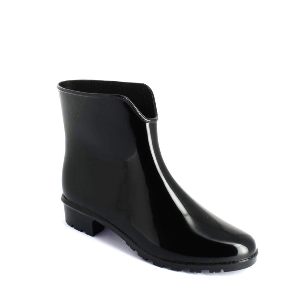 "Sports ankle boot in bright finish pvc, with low heel and ""V"" necked upper part"