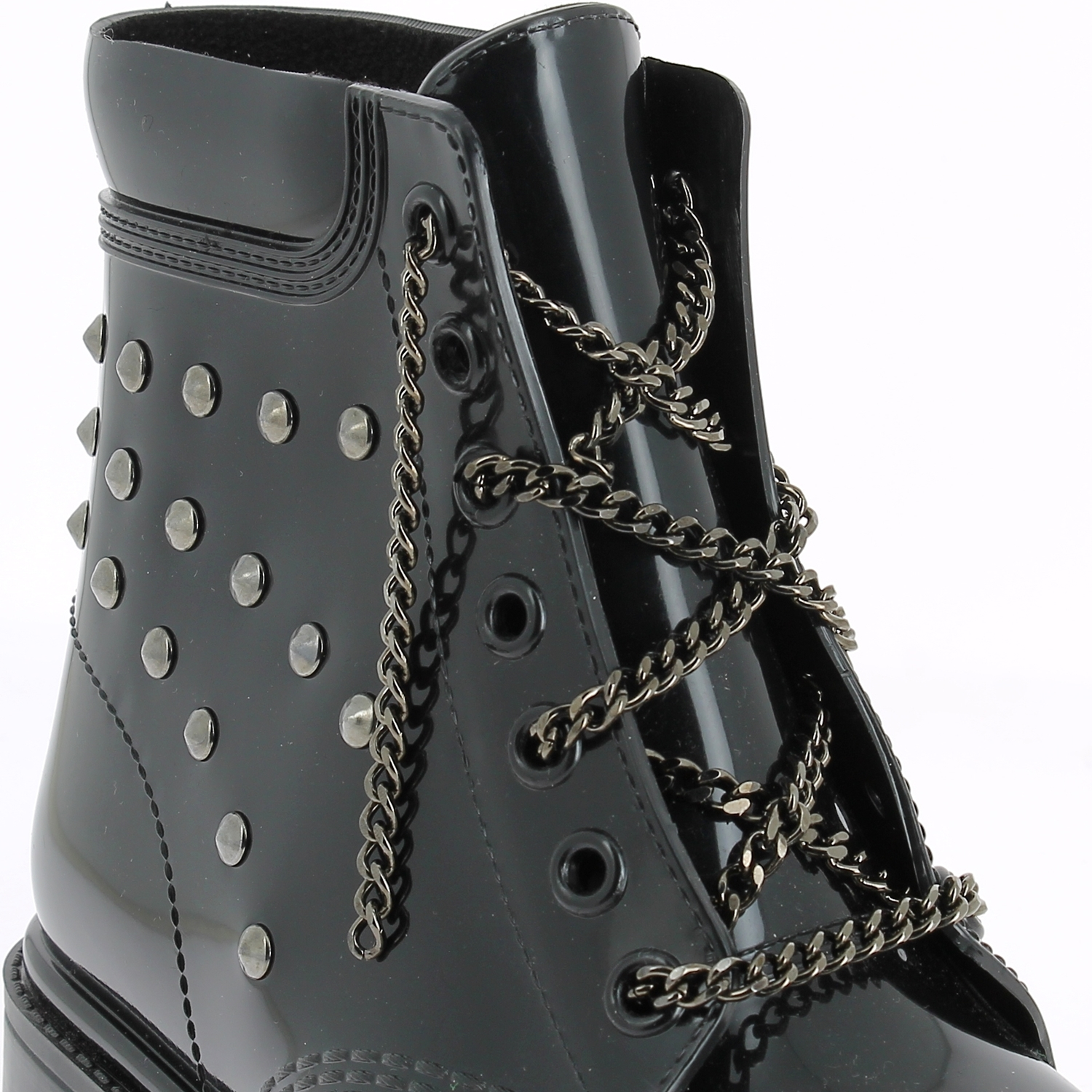 Satin tie with metal end on a pvc short laced-up boot with synthetic fur collar